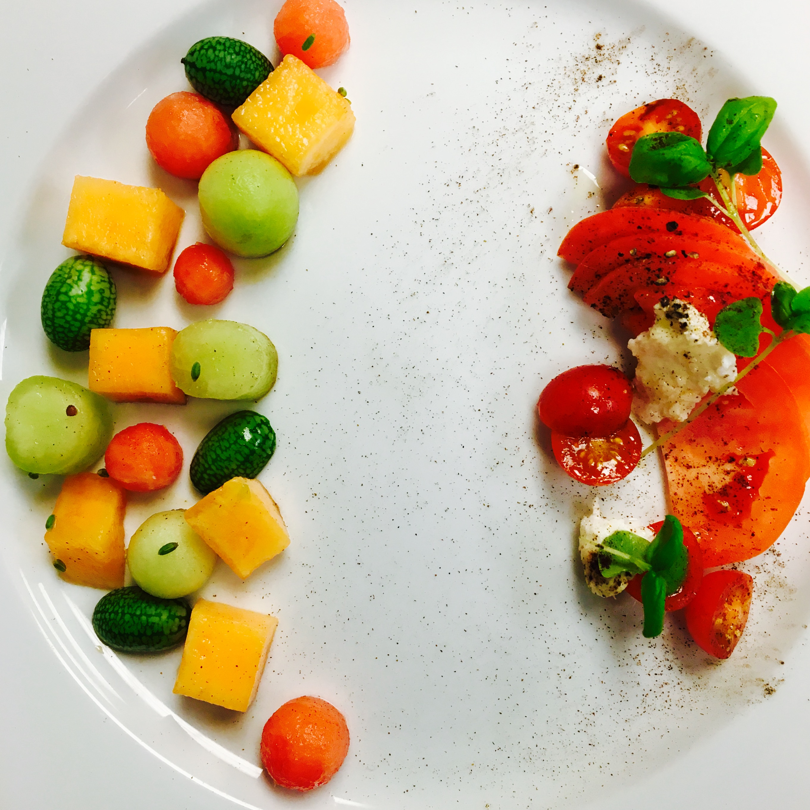 the end result was a fairly laborious design with different cuts of melon and tomatoes elegantly presented to complement the events vibe